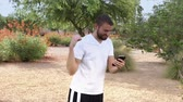 app : CHANDLER, AZ - Circa July, 2016 - A young man plays a Pokemon Go-type smartphone app in a typical Arizona neighborhood. Simulated sphere is flicked from the smartphone.