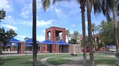 An establishing shot of the entrance to a typical Arizona suburb public park.