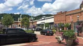 upscale : A daytime establishing shot of stores in a strip mall. Store names and signage removed for general stock use.