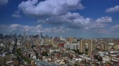 A dramatic day time lapse of puffy summer clouds passing over Midtown Manhattan.