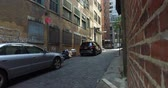 A gritty Manhattan alley dolly up establishing shot. Stock Footage
