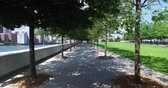 A walking dolly shot of peaceful the treelined paths at Franklin D. Roosevelt Four Freedoms Park on the south end of Roosevelt Island. Stock Footage