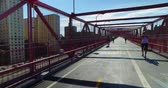 A perspective view on the pedestrian sidewalk on the Williamsburg Bridge over the East River in Manhattan.