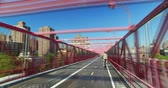 NEW YORK - Circa August, 2016 - A time lapse perspective view as seen while on the pedestrian sidewalk on the Williamsburg Bridge. Stock Footage
