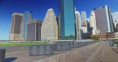 A daytime Manhattan skyline establishing shot as seen from Pier 15 East River Esplanade.