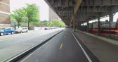 A bicycle riders perspective on the East River Bikeway trail underneath FDR Drive in Manhattan. Stock Footage