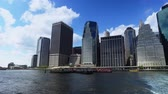 A daytime establishing shot of the lower Manhattan skyline as seen from the East River Ferry.