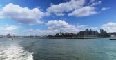 A daytime view of the Brooklyn skyline as seen from the East River Ferry on the way to Governors Island.