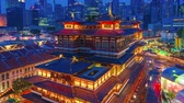 Aerial view video time lapse of Buddha Tooth Relic Temple & Museum in Singapore at night