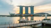 Video Time Lapse Aerial view of Marina bay with Merlion in background day to night timelapse