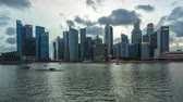 singapore : Timelapse of Singapore city skyline and view of Marina Bay day to night time lapse 4K Stock Footage