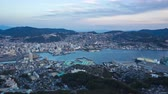 Nagasaki city skyline day to night time lapse in Japan.