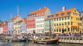 Copenhagen, Denmark - May 1, 2017: Nyhavn waterfront with crowd of tourist in Copenhagen city, Denmark Dostupné videozáznamy