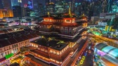 Singapore city skyline at night in China Town of Singapore Stock Footage