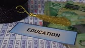 egyetemi : University Graduation cap with Canadian Dollars - Financial concepts Stock mozgókép