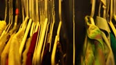 bright clothes : clothes hanging in a closet at home Stock Footage