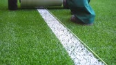 sportler : Marking football stadium field with paint