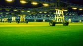 Mobile grow lighting system in sports stadium at night. Vidéos Libres De Droits
