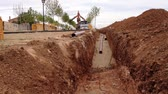 ditch and pipes in construction site, loader Stock Footage