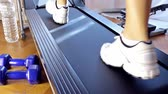 fitness training ; young woman does fitness training on a treadmill,video clip Vídeos