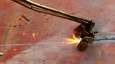 Cutting metal plates ; Cutting metal plates with the gas appliance at high temperature, video clip