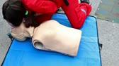 cpr : CPR demonstration ; Emergency workers performed CPR demonstration exercise at a special rubber doll,video clip