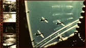granada : Battles of World War II  Processed archival footage from World War II with the mask film strips in a split screen.