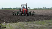 machinery : Agricultural worksowing  Spring planting corn in a field with a tractor and a plantervideo clip