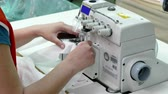 Sewing womens socks ; Sewing machine worker stitching womens nylon stockings