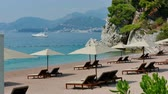 den : Sandy beach in the Mediterranean ; View of the beautiful Saint Stephens beach in Montenegro, 4 K Video Clip