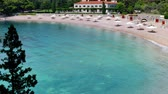 den : Wonderful Place to enjoy the Summer Vacation ; View of the beautiful Saint Stephens beach in Montenegro