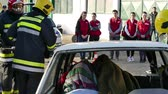 Zrenjanin ; Serbia ; 22.11.2017. Firefighters rescuer team breaks car glass to save injured driver-demonstration exercise. Vídeos