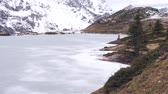 bosques : a frozen mountain lake in the swiss alps Stock Footage