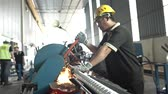 ducts : Factory Worker In Yellow Helmet Cutting Aluminum Duct Pipe On A Machine - Slider - Towards