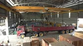 vidlice : Warehouse With Yellow Crane And Red Trolly