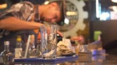 Bartender Pouring Drink In Shot Glass Through Transparent Glass Stok Video