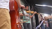 buidling : 2 Guys Busking On Street - Playing Violin & Cello -  Low Angle Stock Footage