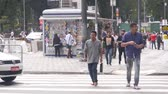 buidling : Asian Man With Black Bag Crossing The Road Stock Footage