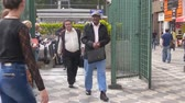 buidling : Compilation of 2 Shots Of People On City Streets Stock Footage