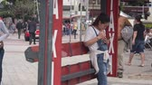konak : Japenese Women In Jeans Waiting At Taxi Stand Stok Video