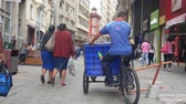 buidling : Person On Cycle Trolley Stuck In A Hole On The Street Stock Footage