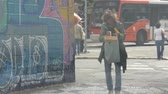 buidling : Sao Paulo - Old Women In Jeans Walking On Street - Side Angle Stock Footage