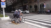 Sao Paulo - Police On Bicycle Waiting On A Signal Stok Video