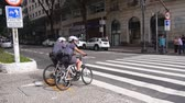 buidling : Sao Paulo - Police On Bicycle Wearing Shorts Waiting On A Signal