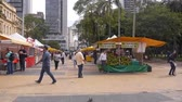 Sao Paulo City - A Small Outdoor Day Market WIth People Walking - Pan - Right To Left