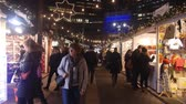 kereszt : People Walking In Christmas Market At Night - Static