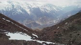 山頂 : Flight above highland water stream running down to mountain valley, Nepal 動画素材