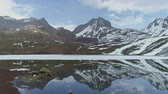 山頂 : Sliding above highland Ice Lake, mirror reflection of snow peaks on water, Nepal