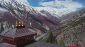 山頂 : Incredible panorama, red pagoda at highlands, snow Tilicho Peak at horizon,Nepal 動画素材