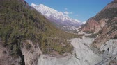 山頂 : Aerial panoramic fly above rocky river gorge, Annapurna snow range, Nepal